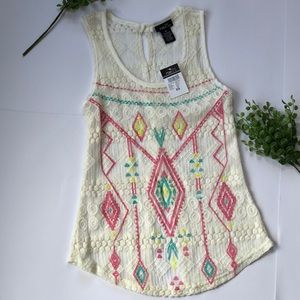 Tops - Cute cream colored tank top with pastel print